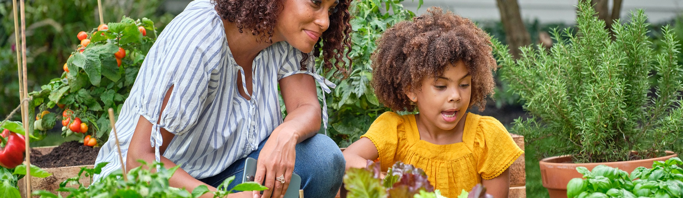 Mother and daughter gardening together.