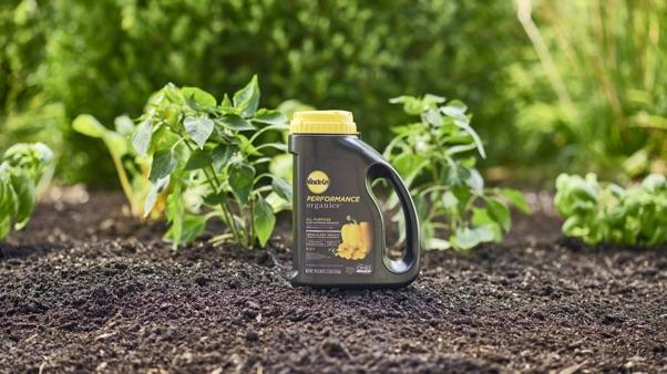 miracle-gro performance organics all purpose plant nutrition granules sitting on soil