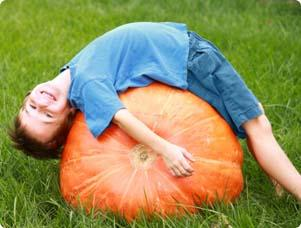 Child Laying on a Giant Pumpkin
