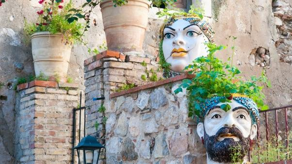 Garden-Inspired Fall Decor: a variety of head-shaped planters