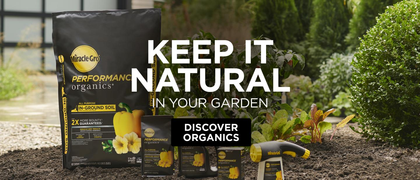 Miracle-Gro® Performance Organics® soils and plant foods placed on the ground.