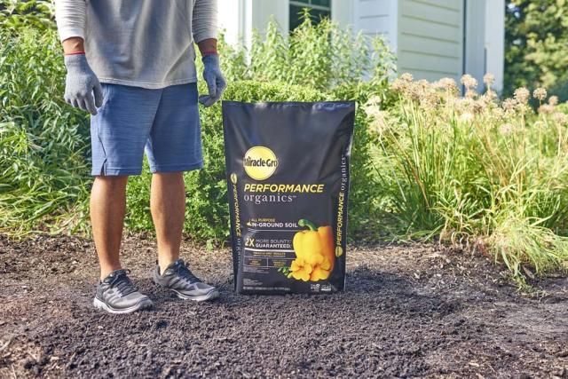 standing next to in-ground soil bag